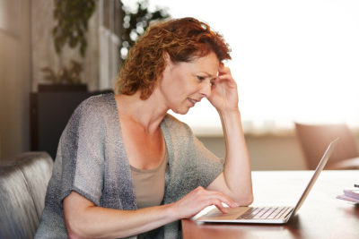 mammogram | thinking woman using laptop | University of Colorado OB-GYN