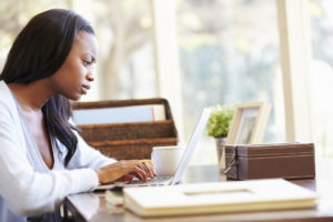 Online medical information | CU OB-GYN | Woman on computer